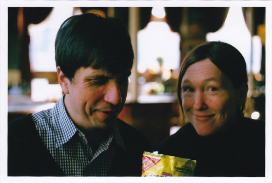 Jim and Emily in London with vegetarian roast beef flavored crisps. Photo by Gail O'Hara